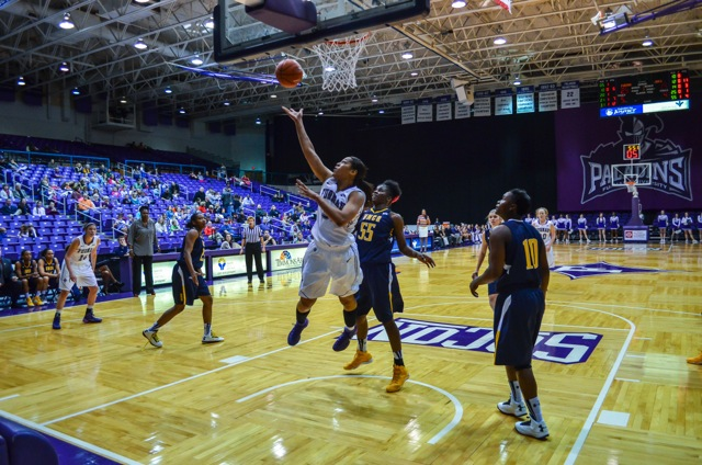 The Furman Paladins score in the paint en route to a nine point victory over conference river UNC-Greensboro last week Photo courtesy of Laura Krueger