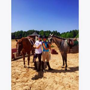 Kinsey Peterson and Haley Steffans pose with their horses at the Furman Equestrian Team stables. Photo courtesy of Furman Equestrian Team