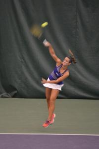 Junior Blair Martin smashes a serve during this weeknd's Furman Fall Classic.  Photo courtesy of Jake Crouse