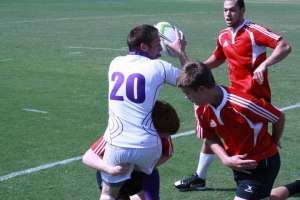 Sammy Hobgood stretching the ball out while trying to avoid a tackling defender.  Photo courtesy of Sammyy Hobgood