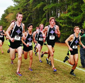 The Furman men's cross country team runs in tight formation at the SoCon Championships. Photo courtesy of Marian Baker