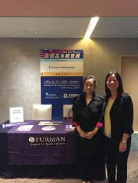 """Candice Chan (right) and Furman alum Wenhui """"Wenphie"""" Qiu (left) recruit Chinese students at a university fair in Shanghai. Photo courtesy of Candice Chan."""